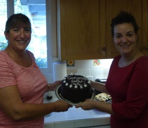 "Roberta and Sarah with Sarah's celebratory ""Mark Transmission"" cake"